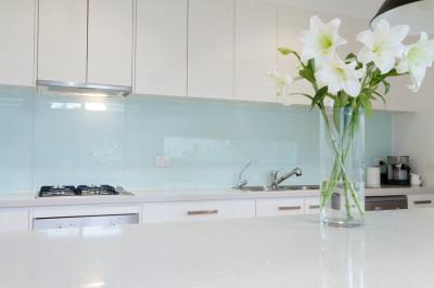 Flowers on white kitchen bench